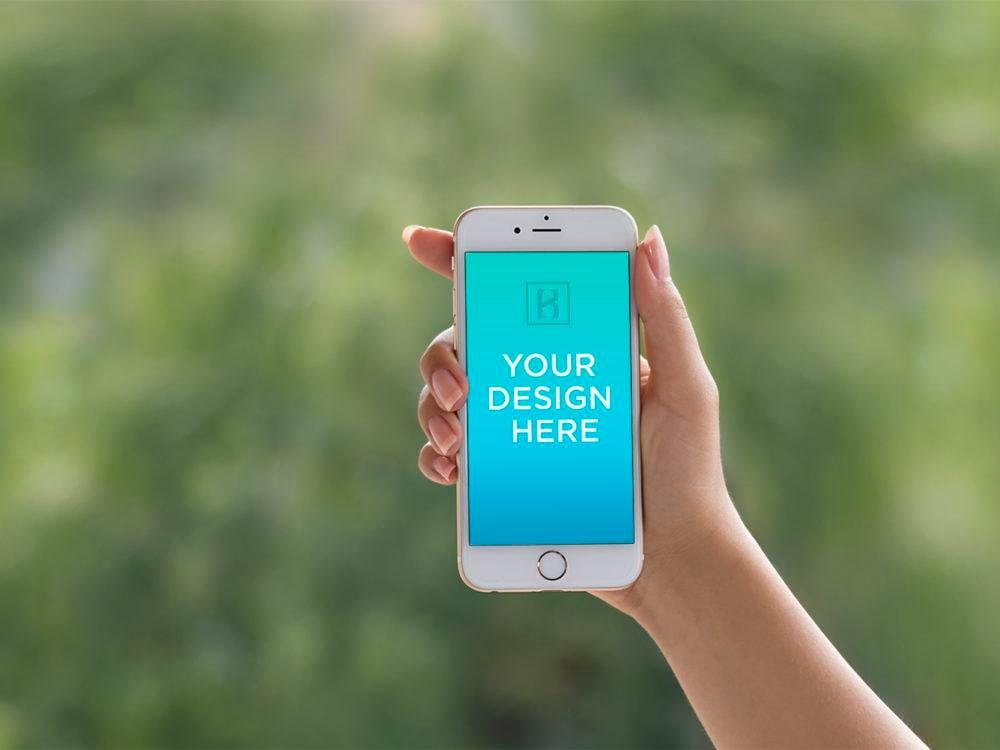 iPhone 6 in female Hand Mockup