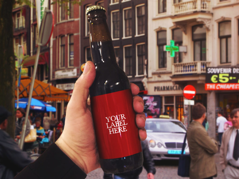 Bottle of Beer in hand – Free PSD Mockup