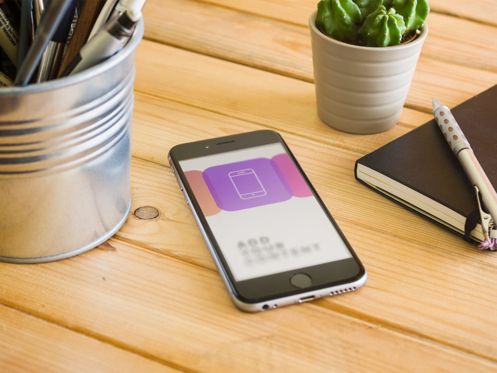 iPhone 6 on Wooden Table Free PSD Mockup