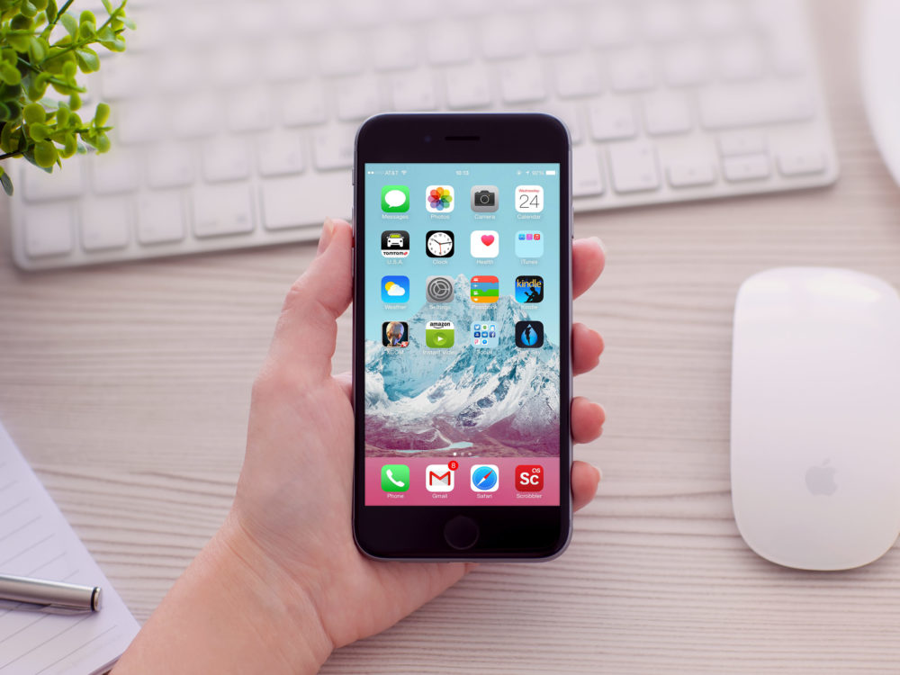iPhone 6 in Hand Free Mockup