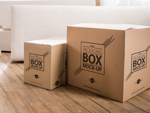 Free Packaging Box on Wooden Floor PSD Mockup