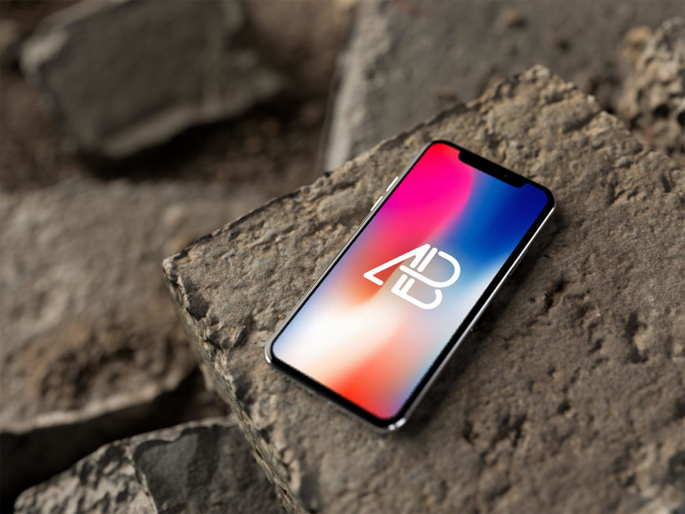 iPhone X on Rocks Free Mockup