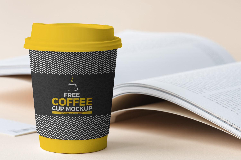 Free Coffee Cup Beside Book Mockup 2018   Free Mockup