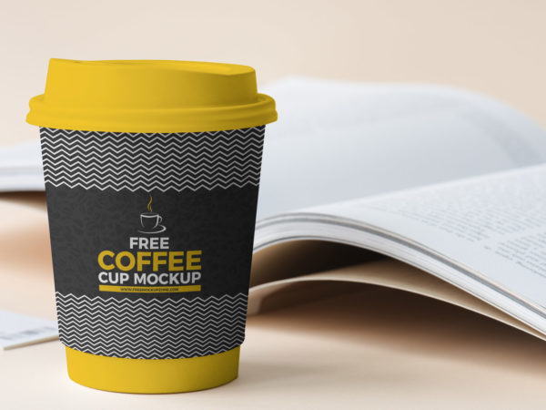 Free Coffee Cup Beside Book Mockup 2018