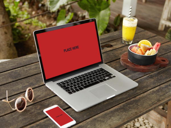 Smartphone With Laptop Mockup on Wooden Table