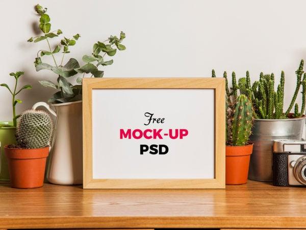 Wood Photo Frame on the Desk Free Mockup