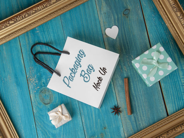 Free Gift Bag Mockup on a Blue Wooden Background