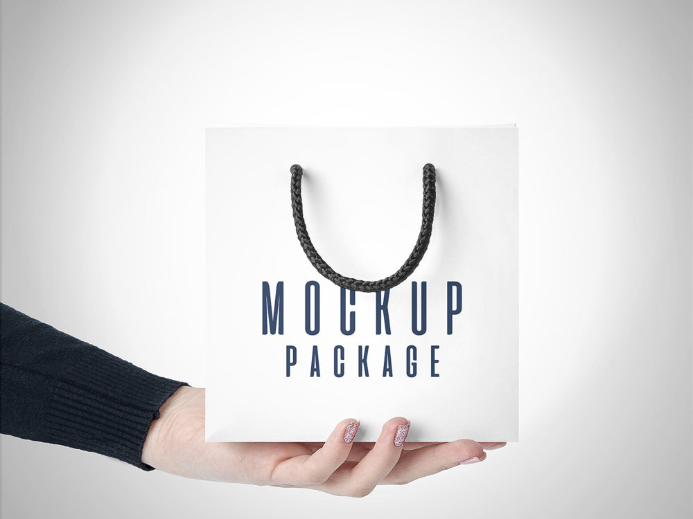 Gift Bags in Hands Free Mockup