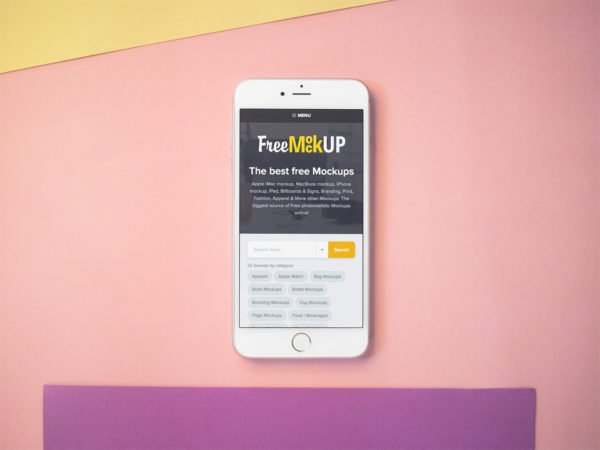 Free Mockup of an iPhone Lying on a Pink Surface by Placeit
