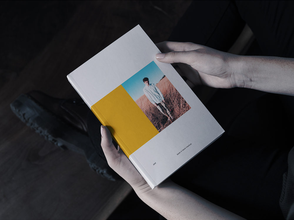 Book in Hand Mockup Free
