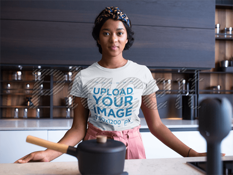 Woman Wearing T-Shirt in Kitchen Free Mockup by Placeit