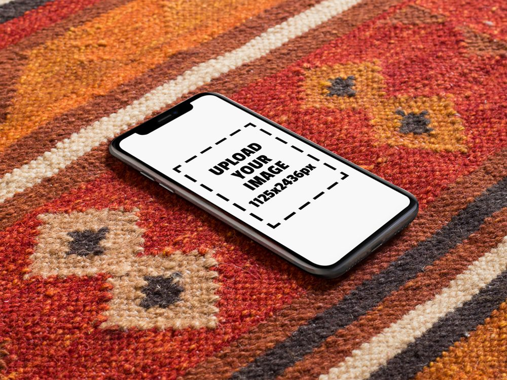 iPhone X Mockup Lying on a Red Carpet by Placeit