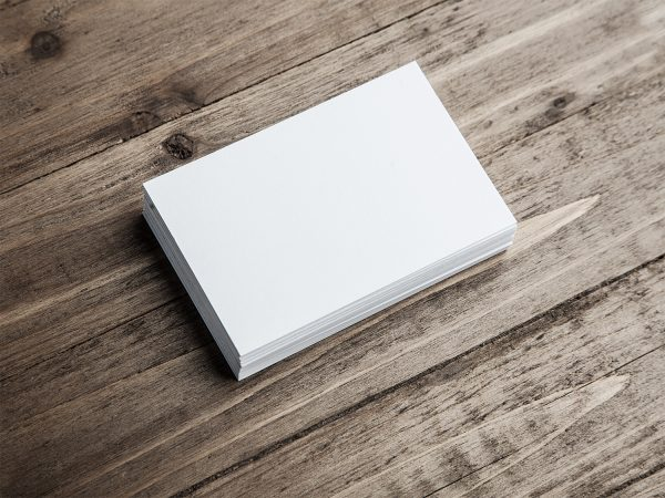 Free Business Cards Mockup on a Wooden Background