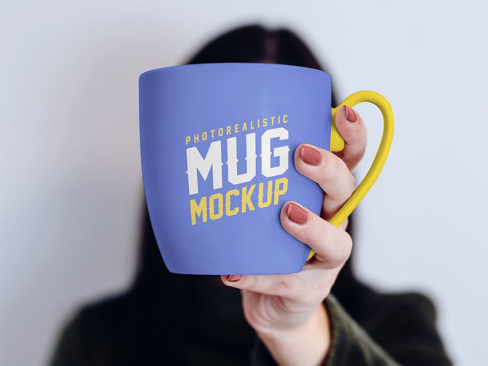 Free Mug in Female Hand Mockup PSD