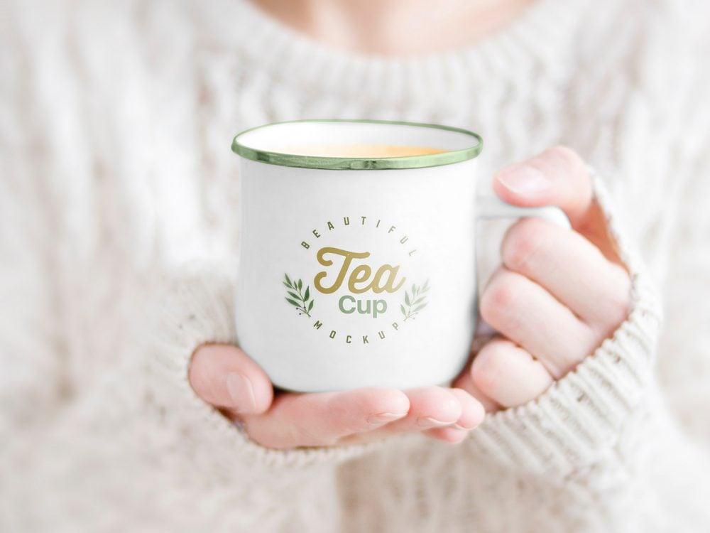 Female Holding Tea Cup Free Mockup