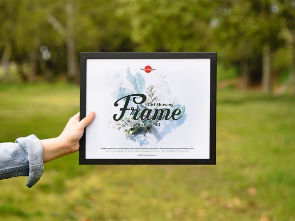 Girl Showing Picture Frame Free PSD Mockup