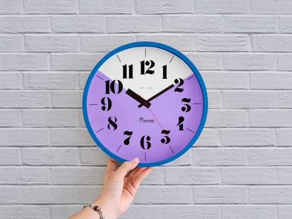 Free Wall Clock in Hand Mockup PSD
