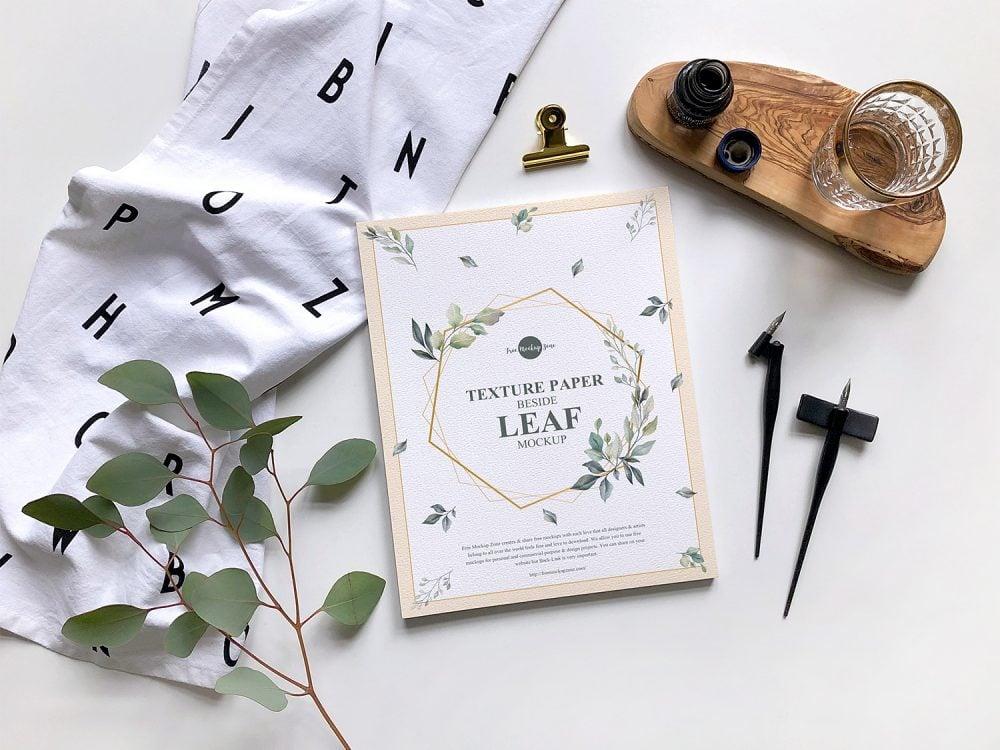Free Texture Paper Beside Leaf Mockup