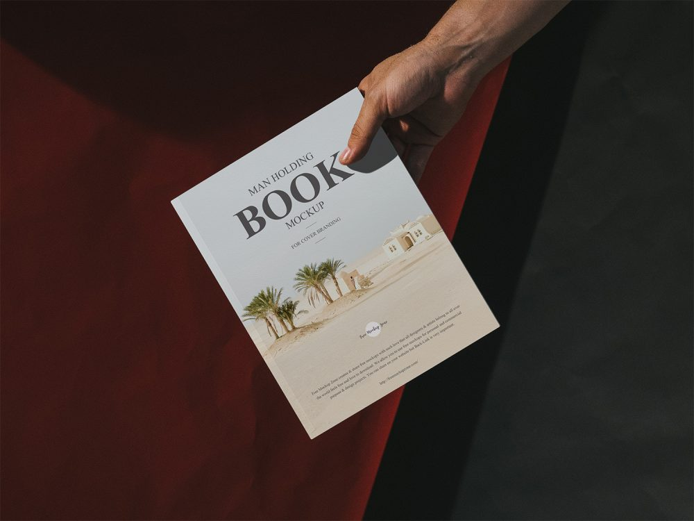 Man Holding Book Free Cover Mockup