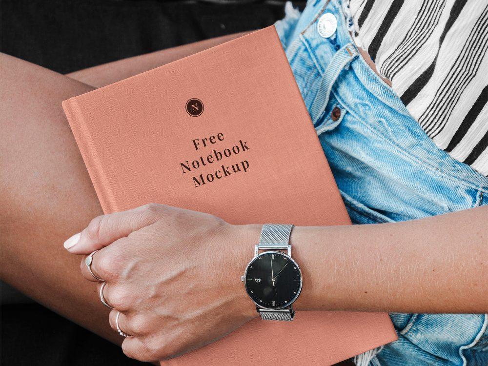 Hand Holding Hardcover Notebook/Catalog Mockup