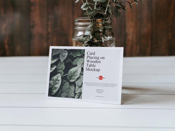 Free Greeting Card Mockup on a Wooden Table