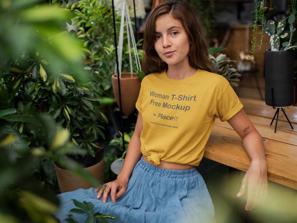 T-Shirt Mockup of a Woman Relaxing in Her Garden