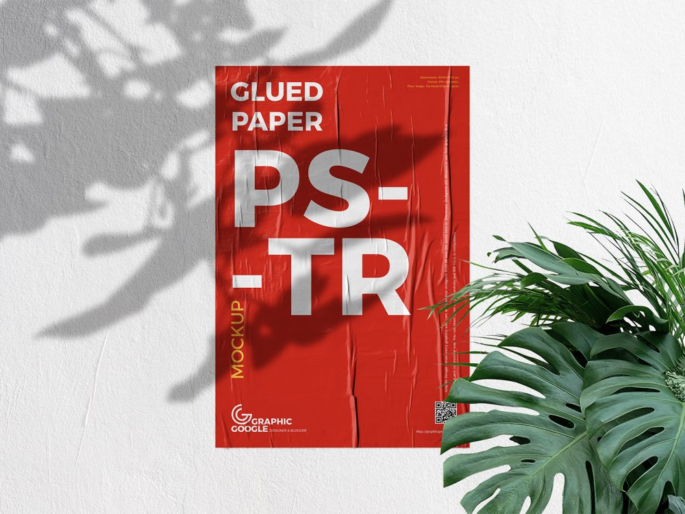 Free Glued Poster Mockup on a Concrete Wall