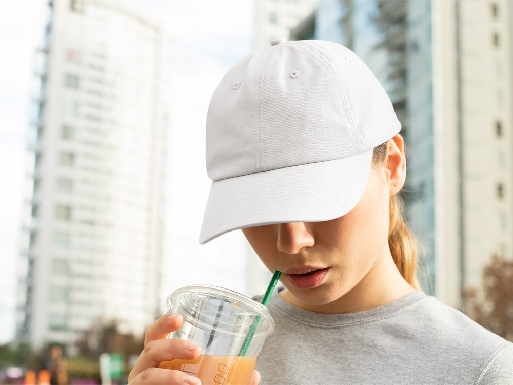 Dad Hat Mockup of a Woman with a Beverage