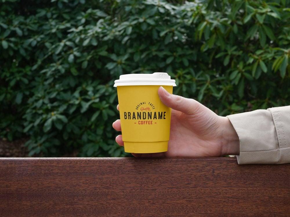 Hand Holding Coffee Cup PSD Mockup