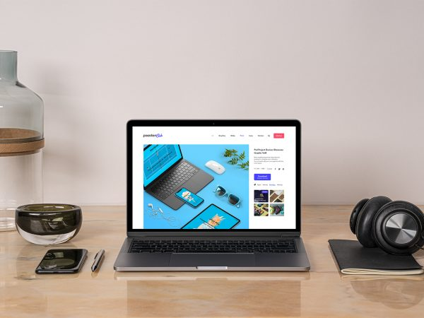 MacBook Pro Mockup on a Desk Workspace Scene
