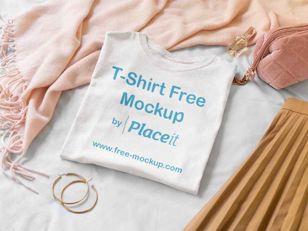 Folded T-Shirt Mockup Surrounded by Girly Garments