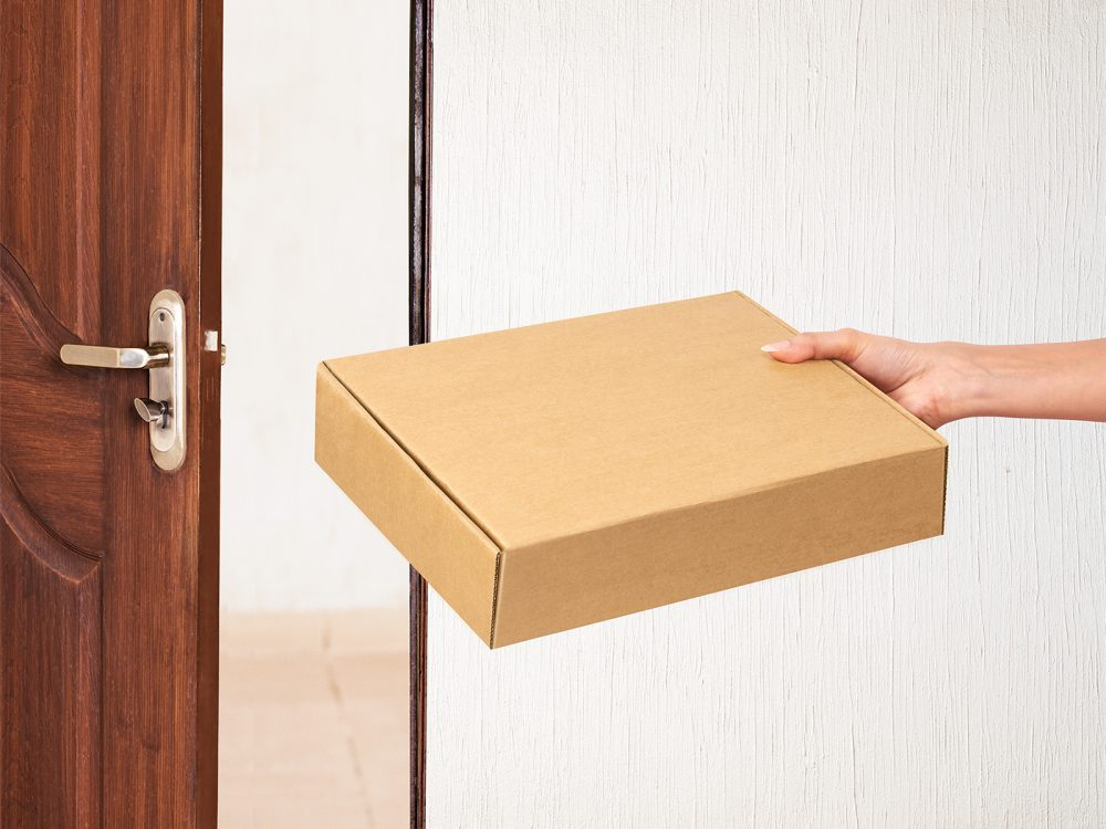 Mailing Box Free Mockup in Hand