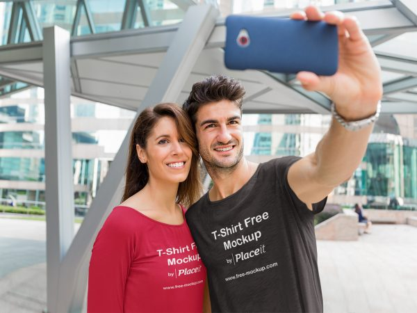 Round Neck T-Shirt Mockup of a Couple Taking a Selfie